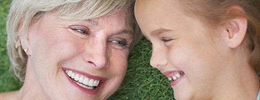 Woman and Her Granddaughter Laughing Together --- Image by © Royalty-Free/Corbis